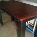 Decorative edge wood stained table